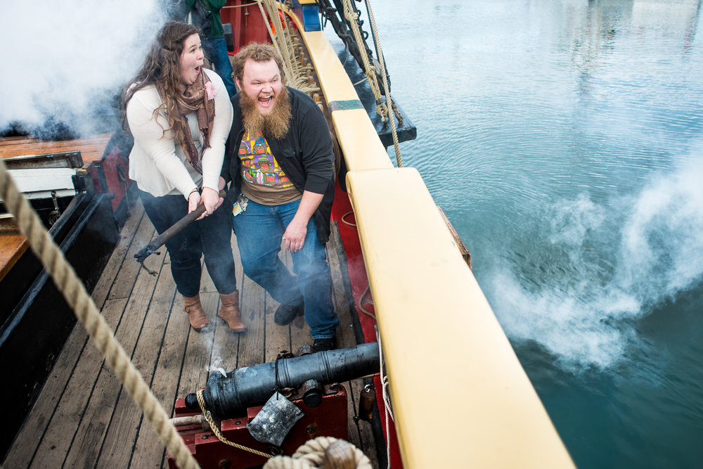 James Hall and Megan Morton react to the noise of a cannon aboard the historic sailing ship Lady Washington in the Port of Newport on Friday, May 19. Hall proposed to Morton on the deck of the ship during a tour earlier that day.