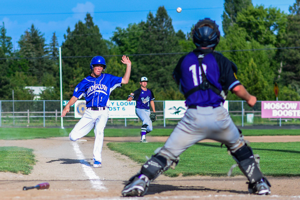 A Moscow baserunner loses his race to home plate against a ball thrown from third base during a 2015 summer game at home in Moscow, Idaho.