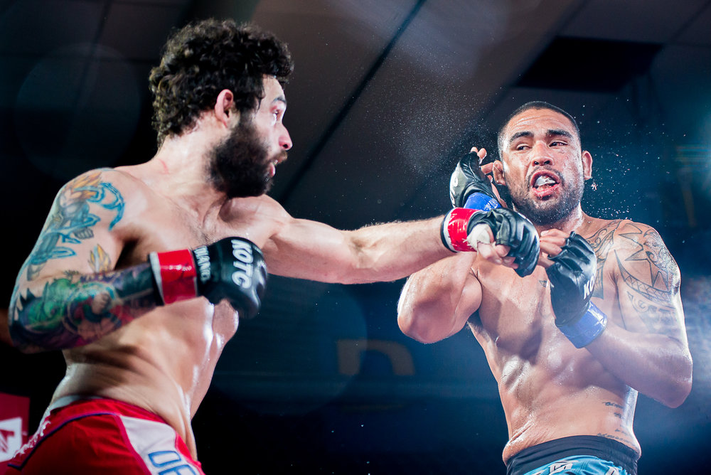 Scotty Hoa (left) lands a punch on Jake Smitty (right) during a Jr. Welterweight King of the Cage fight at the Chinook Winds Casino in Lincoln City on Saturday, May 27.