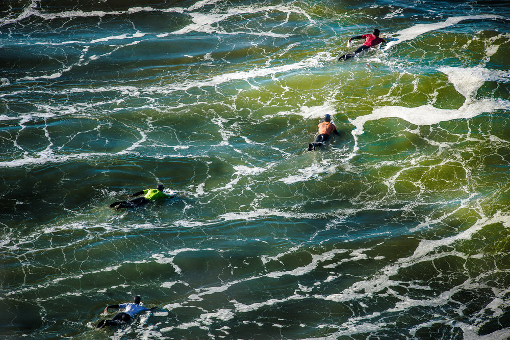 Competitors paddle out during the 2016 Agate Beach Surf Classic in Newport, Ore.