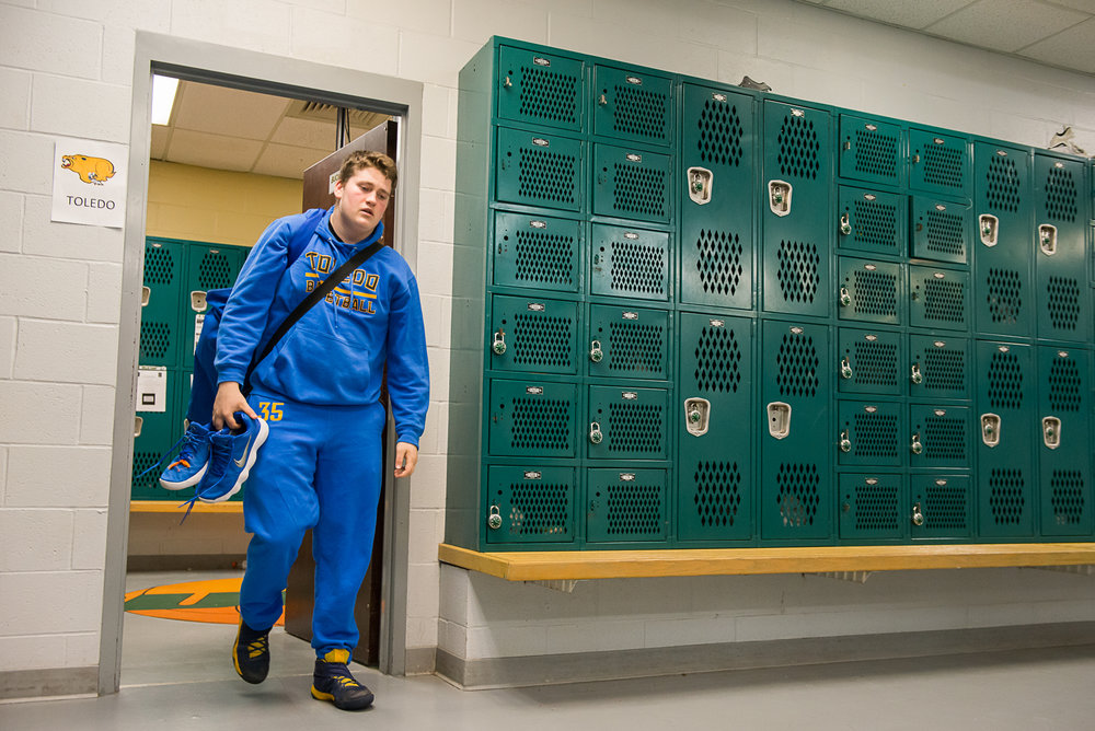 Senior Nate Cross is the last to leave the team's locker room following their elimination from the tournament. Cross is the only senior on the team and will end his high school career without seeing a state title.