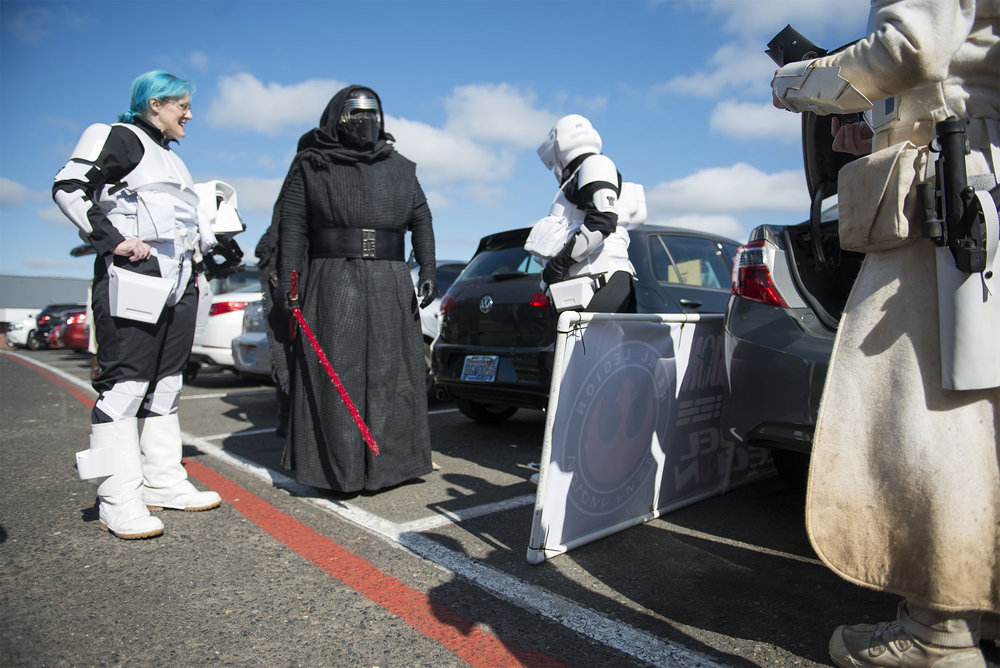 """Timberly Eyssen, left, jokes with members of the 501st Legion, a Star Wars cosplay group that Eyssen joined as part of her recovery, during the Battleground Harvest Days Parade on Saturday morning, July 21, 2018. The 501st marched as part of the annual parade, but Eyssen had to leave early due to pain in her foot and exhaustion. """"What I have learned through my recovery is I just don't push myself if I think the consequences could be bad,"""" she said while walking back to her car."""