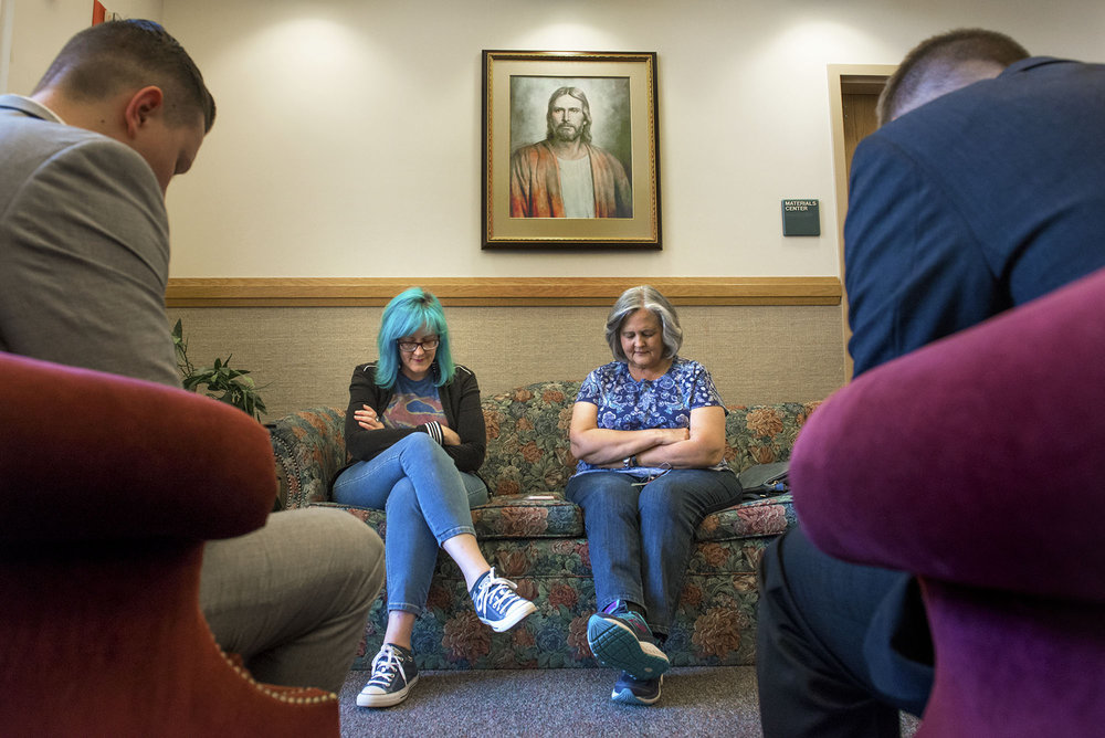 Elder Tanner Taysom, from left, Timberly Eyssen, Terry Bonewell, and Elder Brogun Tibbitts bow their head in prayer as part of a bible study at the Church of Jesus Christ of Latter Day Saints in Salmon Creek on Thursday afternoon, July 19, 2018. Eyssen returned to the church at the beginning of her recovery and met with Bonewell while she was in the hospital recovering from her broken foot.