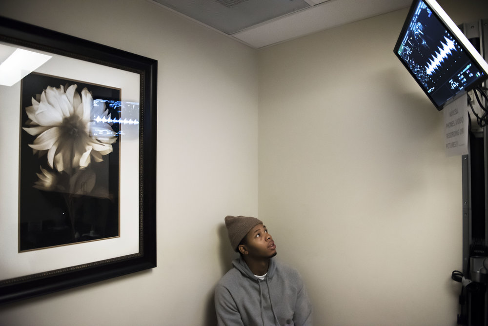 Derrick Hayes of Portland, watches his baby's heartbeat on a monitor during an ultrasound appointment at the PeaceHealth Medical Maternal Fetal Medicine Clinic in Vancouver.