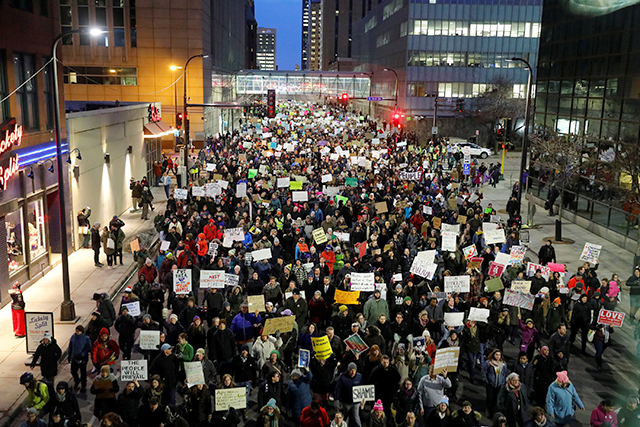 People gathered outside the Federal Building to protest President Donald Trump's executive order travel ban in Minneapolis on Jan. 31. Image source: REUTERS/Adam Bettcher