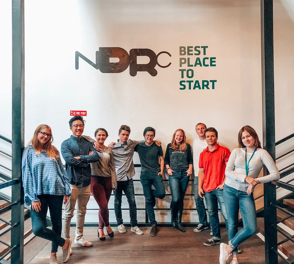 Tatum (right), Jacob (second from right), and the other Sage Corps fellows working at the NDRC.