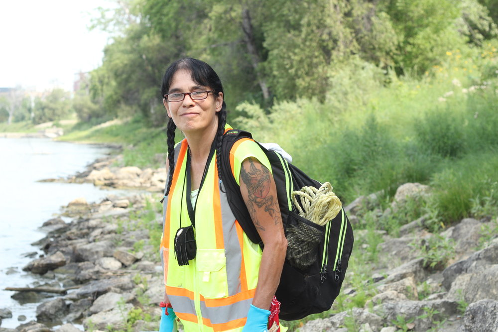 Kim Kosiuk leading the ground search on the Red River banks.