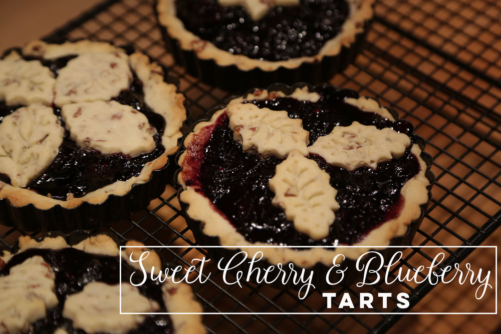 Sweet Cherry and Blueberry Tarts - Enjoy a taste of summer no matter the weather with these juicy sweet tarts. Click the photo for recipe.