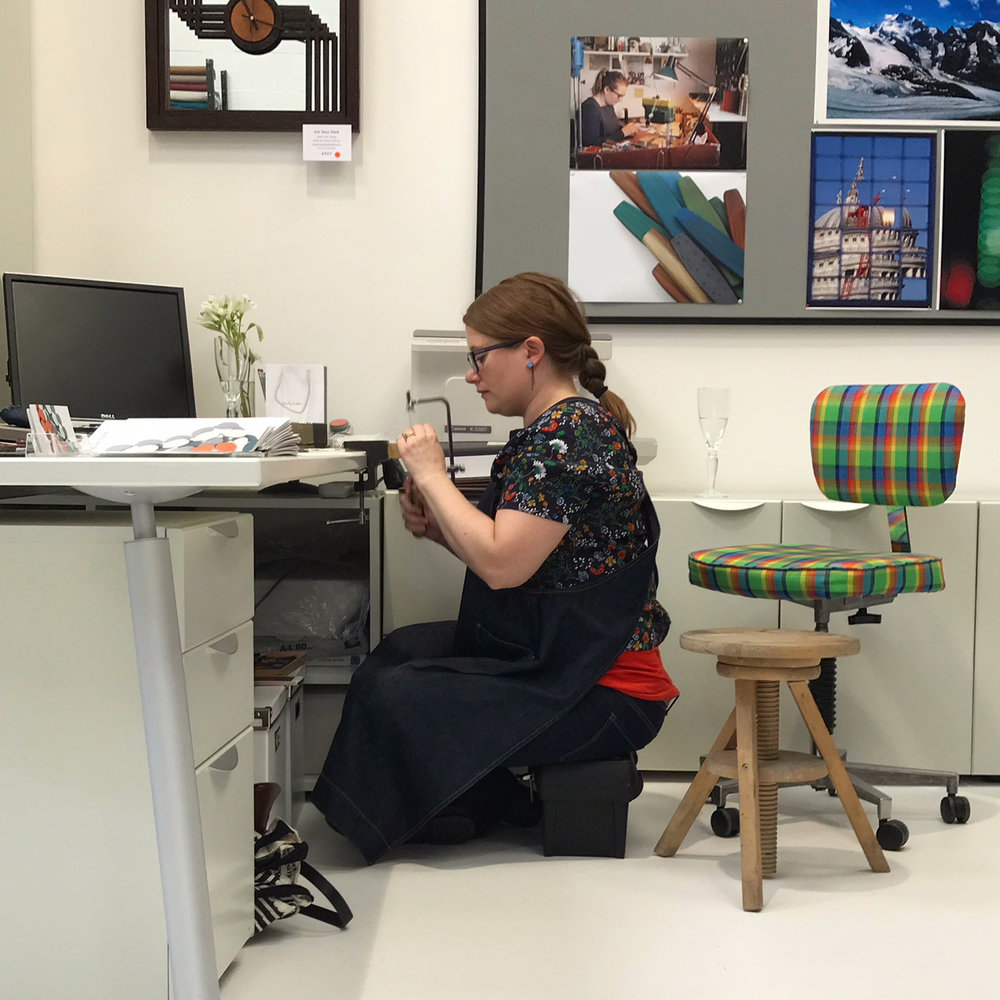 Me demonstrating! I sat on my tool box to get vaguely the right height for working at a desk.