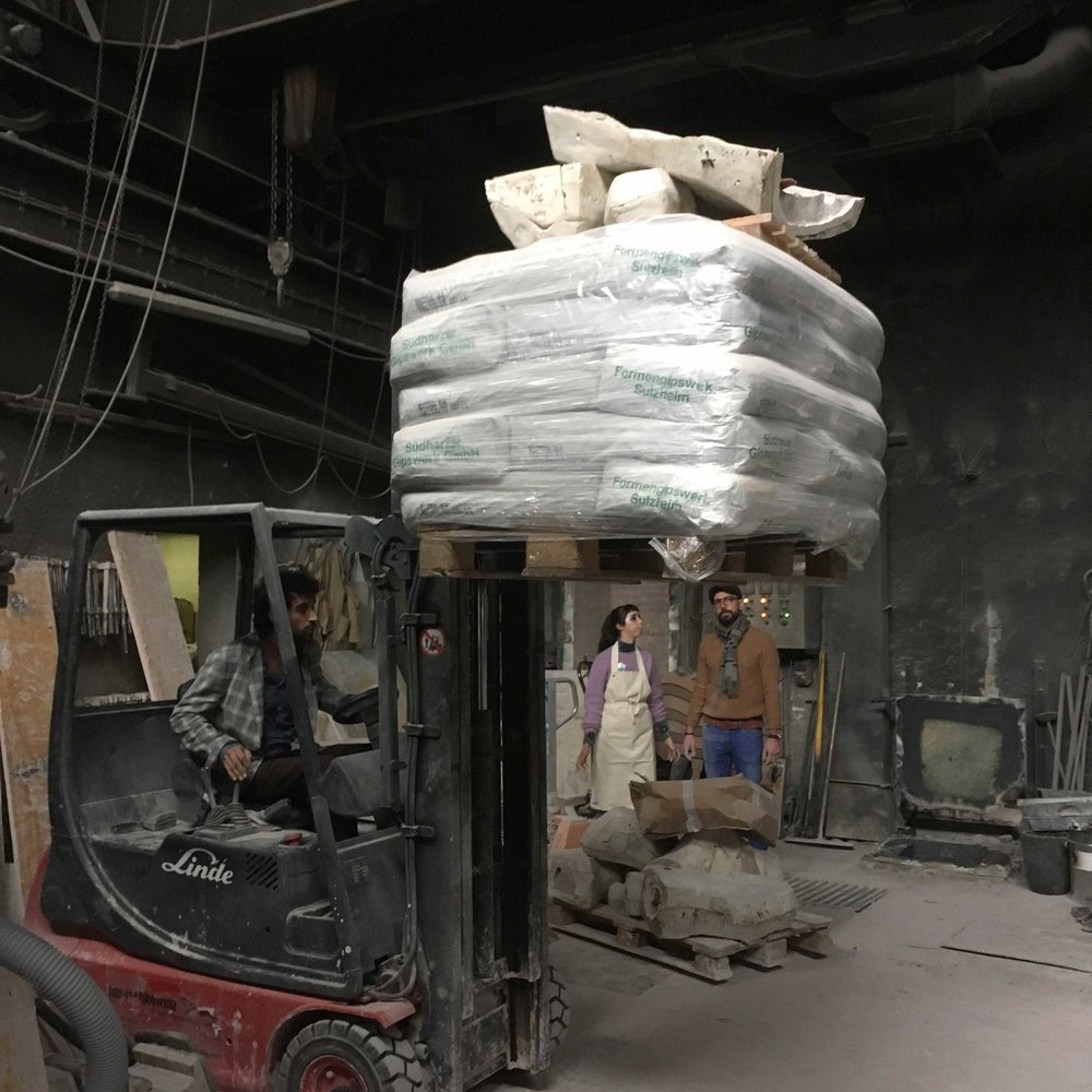 Moving massive pallets of plaster to create our table.