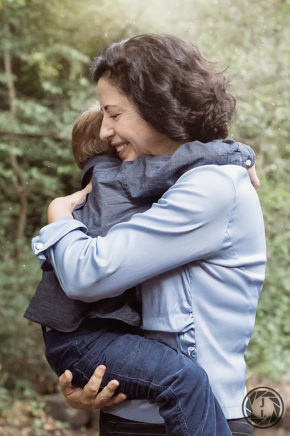 color image of mother hugging her son