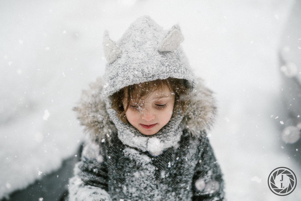 A little girl enjoying the first snow storm in New York City this year.