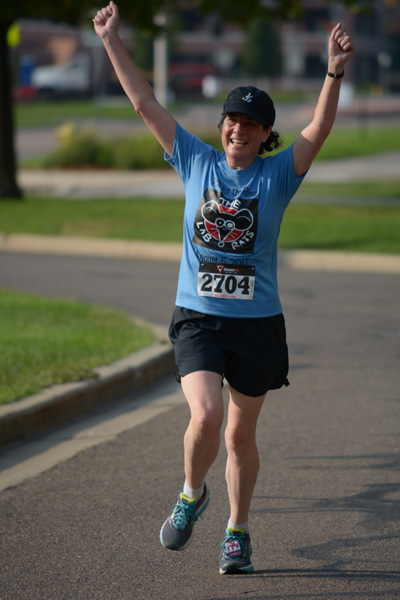 Lori finishing the BDC Run for the Ring, 2017