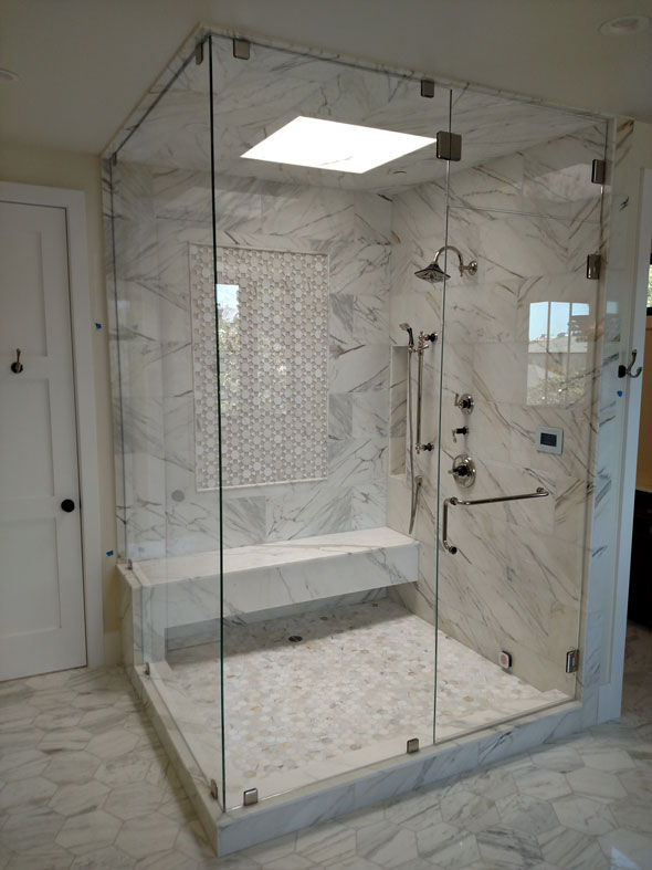 A Starphire (ultra-clear) Low Iron glass steam shower with operable transom, Cheviot Hills (Beverly Hills) CA.