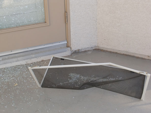 A fiberglass window screen damaged during a break-in robbery.