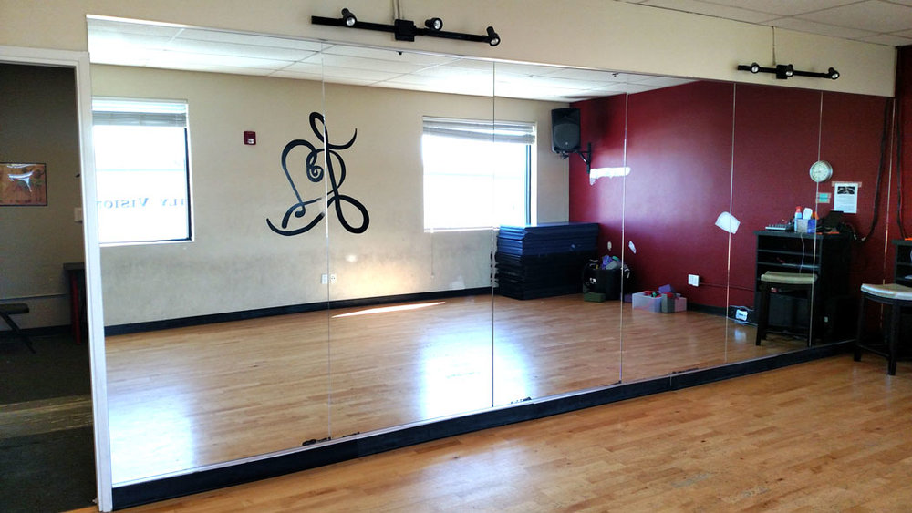 A new bank of mirrors right after installation at a local dance studio/gym, Valencia, CA.