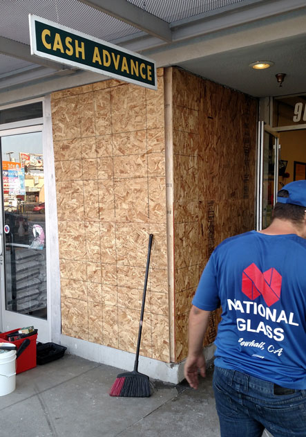 A car drove through this storefront in Arleta requiring a board-up and storefront replacement.