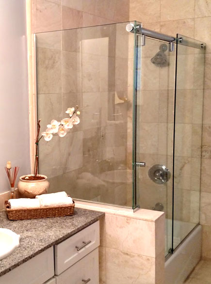 """A 3/8"""" heavy glass frameless shower with channel installed at a bathroom remodel in Newhall, CA"""