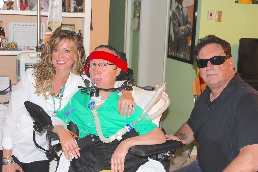 LAGUNA WOODS VILLAGE, Left to Right: Keira Dux, John Lombardo Jr. (sheer joy visible in his eyes), and namesake of the main character in the movie Bloodsport, Frank Dux during a requested private appearance in the Lombardo manor.