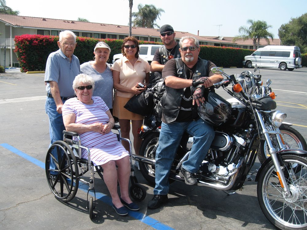 Racing the wheelchair...Mae Richiusa seated (from left to right), Sam pushing the chair, sister Lynda, sister Judy, stepson Jeremy and Gary.