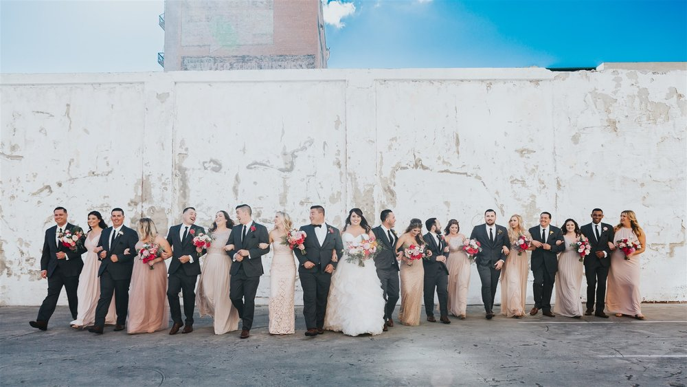 Just a few of their favorite people! Wedding party photos outside of The Loft on Pine, downtown Long Beach.