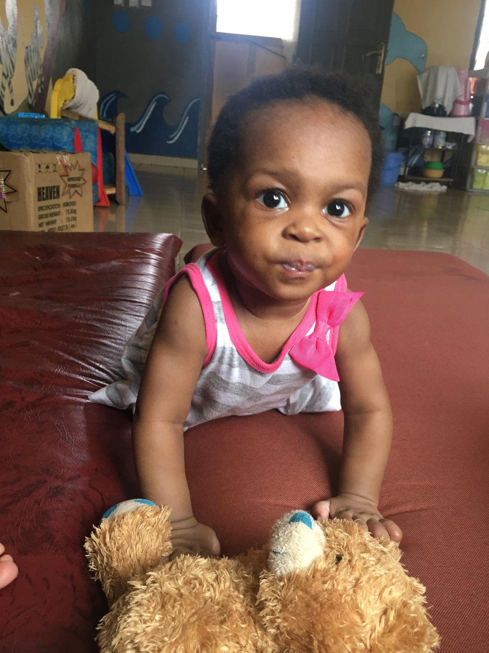 Nkansah - Nkansah my baby. The first baby I held at the orphanage. The first one I fell in love with. She is about 6 or 7 months old. She has these big curious eyes that almost look too big to be on a baby. I love them. She is my little busy body. When I first arrived there, she could not even crawl yet, but was crawling all over the place and even pulling herself up to stand by my third week. Eboni and I call her our twerking baby because she loves to rock back and forth on her hands and knees when she's happy. She also loves to climb on people. Literally has no regard for her little fingers poking you in the eye, slapping another baby in the face, digging her little foot into your chest.  I got a ring made that has her name engraved on it. I'm sure when she gets older, people there will tell her about me, as all the staff and house mothers refer to me as