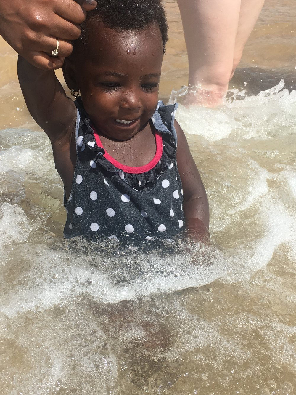 This little girl's family worked on the beach. She was so adorable and fearless!! She loved the water.