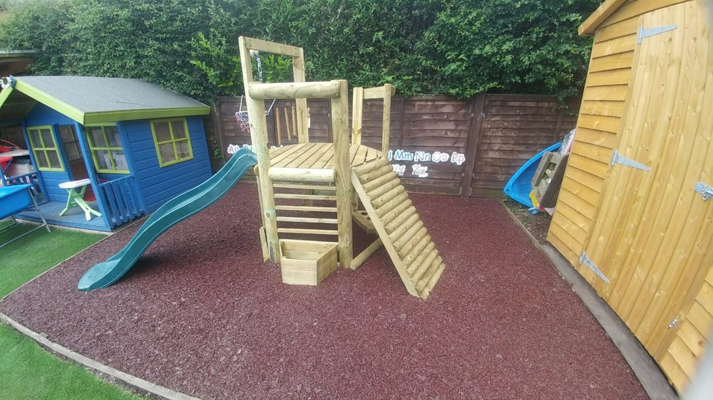 The surfacing is down, and the climbing frame is in position. Let's play!