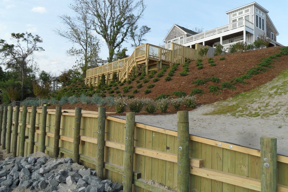 Bulkheads and Retaining Walls - (Timber or Vinyl) Construct new timber and vinyl bulkheads that protect your waterfront property from erosion. Typical construction consists of round 2.5 CCA treated pilings, horizontal wales, treated marine grade sheathing or vinyl sheet panels, bolted with galvanized hardware, and tied back with galvanized anchor rods to 3'x3' deadmen, facia board & decked cap piece. LSI is the only local company that provides a 20 year warranty against structural and material defects and any back fill loss due to leakage through the bulkhead.