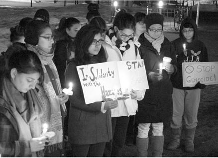 Photo courtesy of Risha Sinha '14 | Students attended the candlelight vigil held in front of the Campus Center on Monday night.
