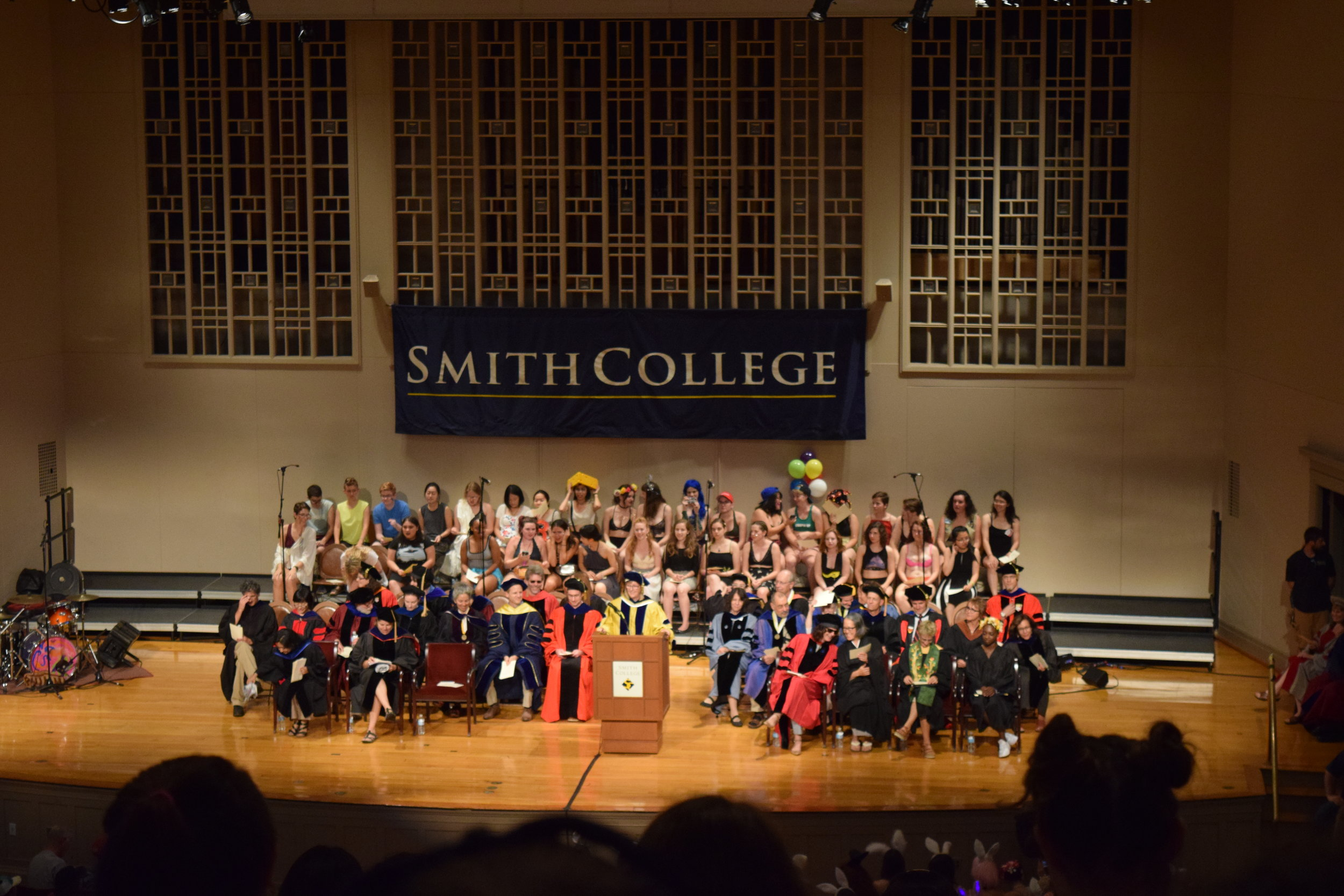 Photo By Katie Heald '18 | President Kathleen McCartney was joined on stage by Smith faculty and the college's glee club while she welcomed students to the 2016-2017 academic year.