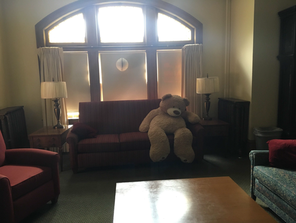 Exhibit 5 from the investigative report into the incident on July 31, 2018 shows a large teddy bear in Tyler House's living room.