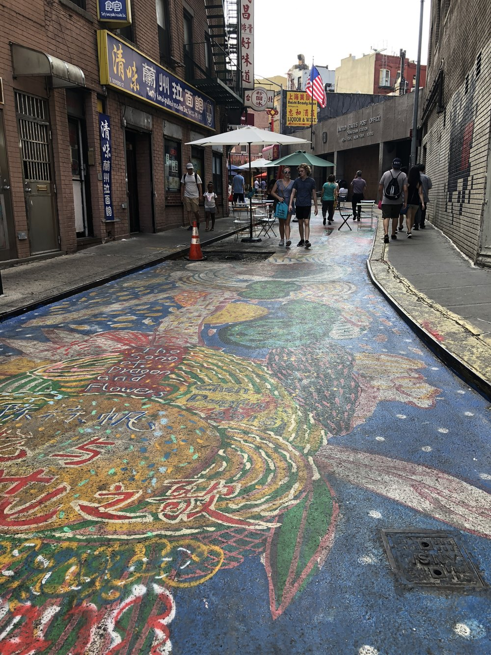 A mural on the street by artist Chen Donfan: The Song of Dragon and Flowers.