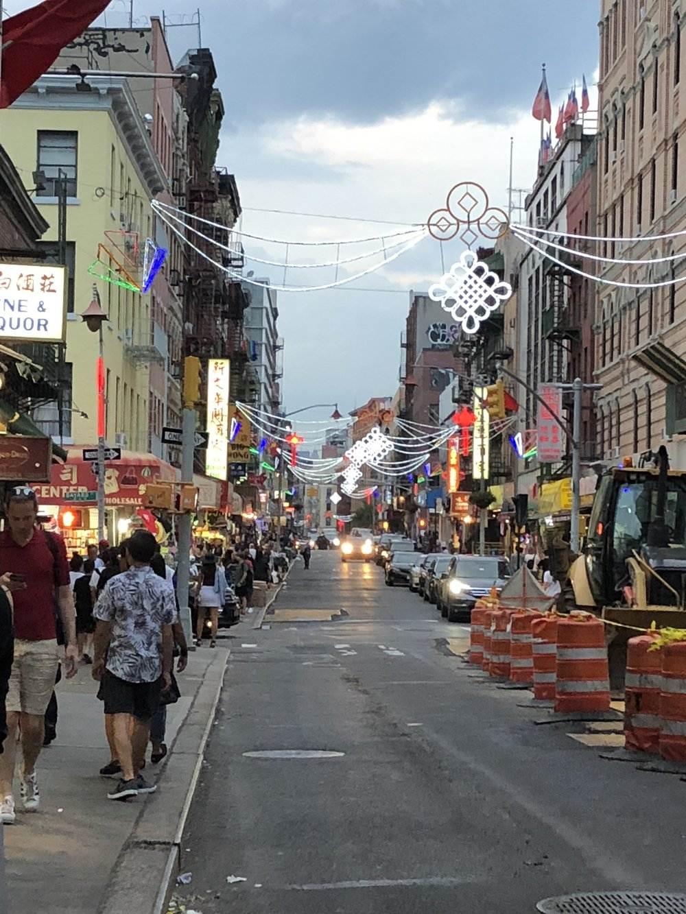 The busy streets of Chinatown. People and construction around every corner.