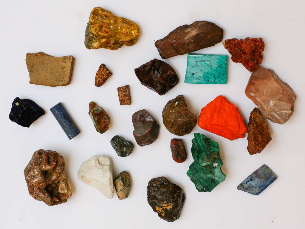 Raw mineral stones when wet, showing different qualities to their characteristics when dry.