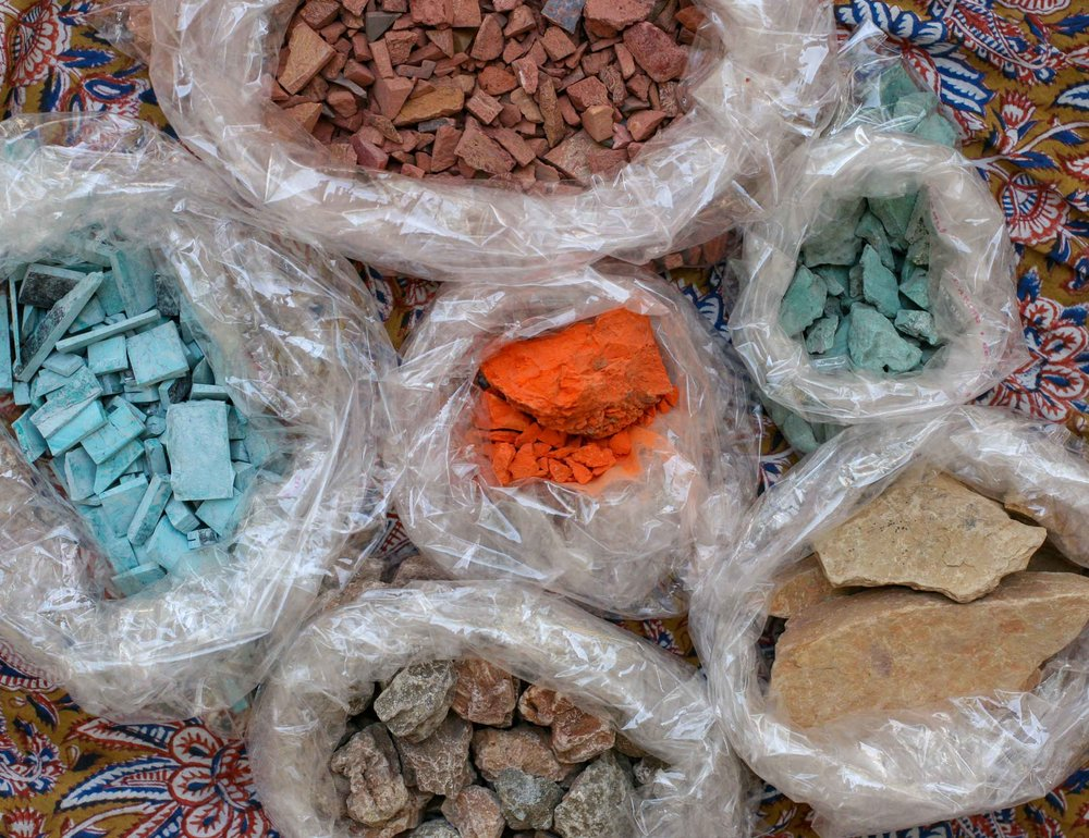 Raw minerals arrive as various sized stones, ready to be ground down and turned into pigment.