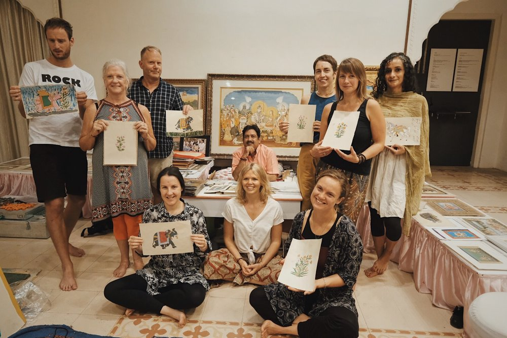 INSPIRED INDIA 2018 group, with Sri Ramu Ramdev (back centre) and Victoria Leader (front centre). Finished paintings at the end of the day. Photography by Precious La Plante.