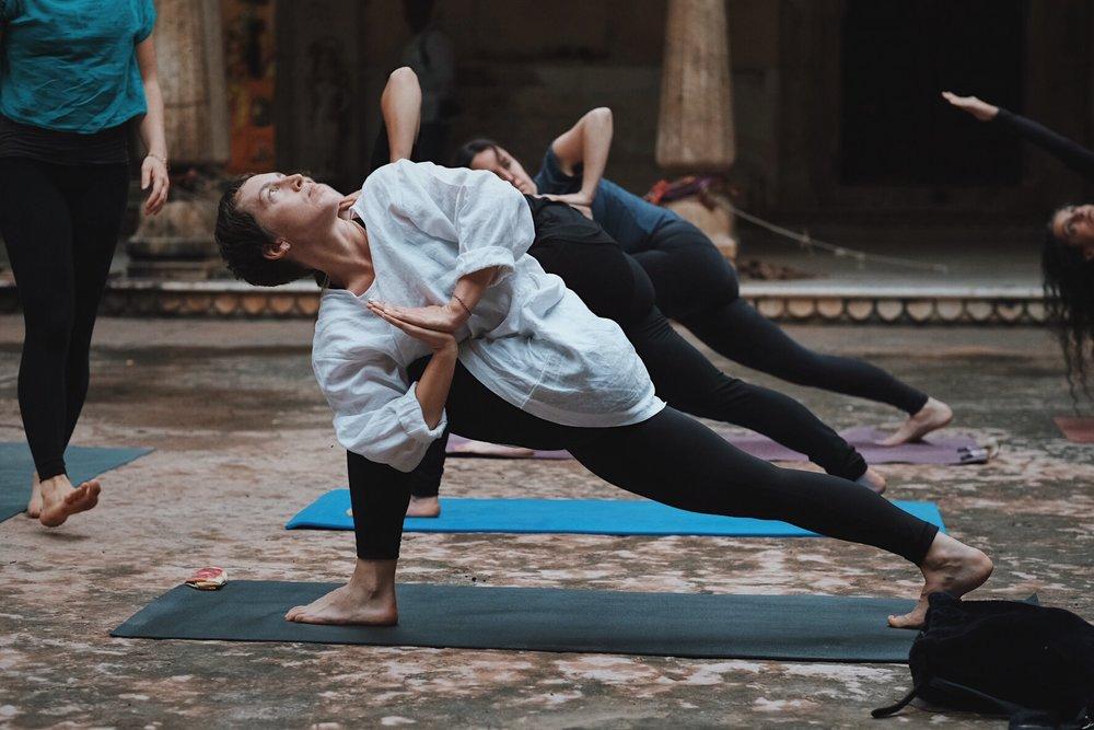 Prvritta Parsvakonasana. Yoga session at Shri Galtaji, Inspired India 2018. Photography by Precious LaPlante.