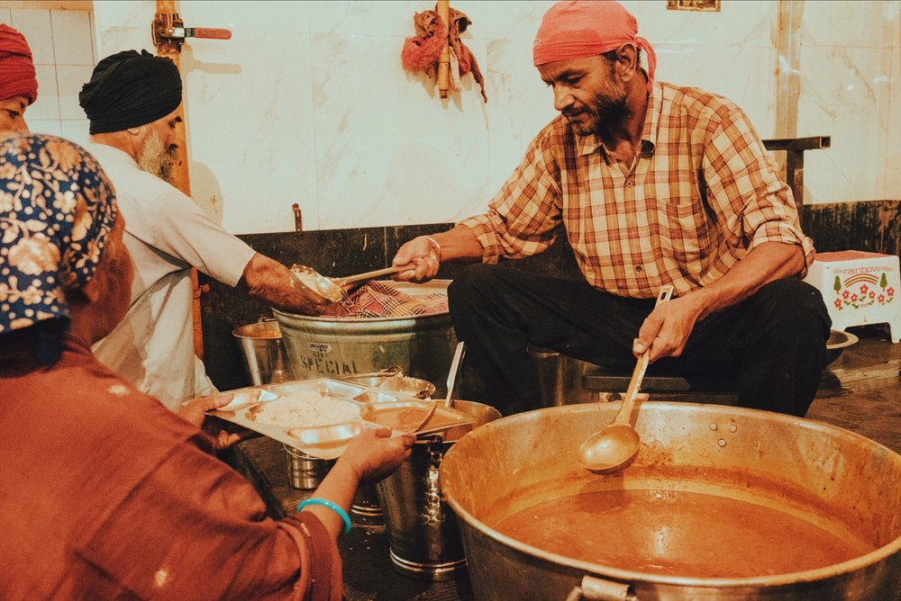 Volunteers serving meals, Langar of Gurudwara Bangla Sahib, Jaipur