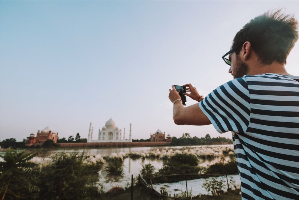 View of the Taj Mahal and Yamuna River from Mehtab Bagh gardens.