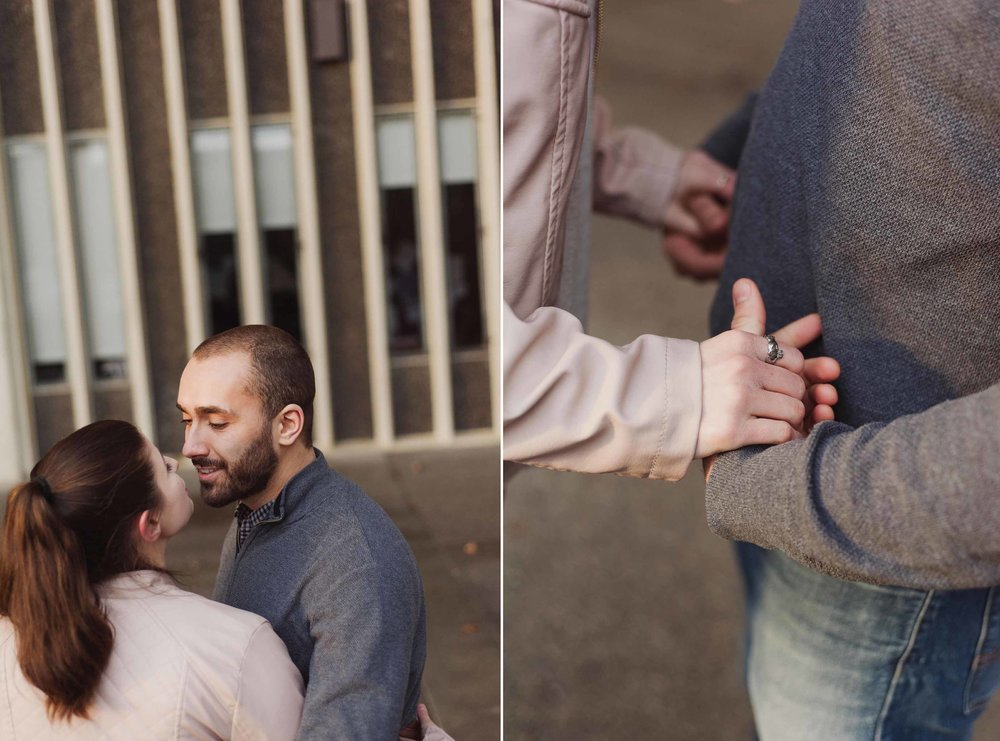 A young caucasian man and woman hold hands and kiss on the University of Albany campus.