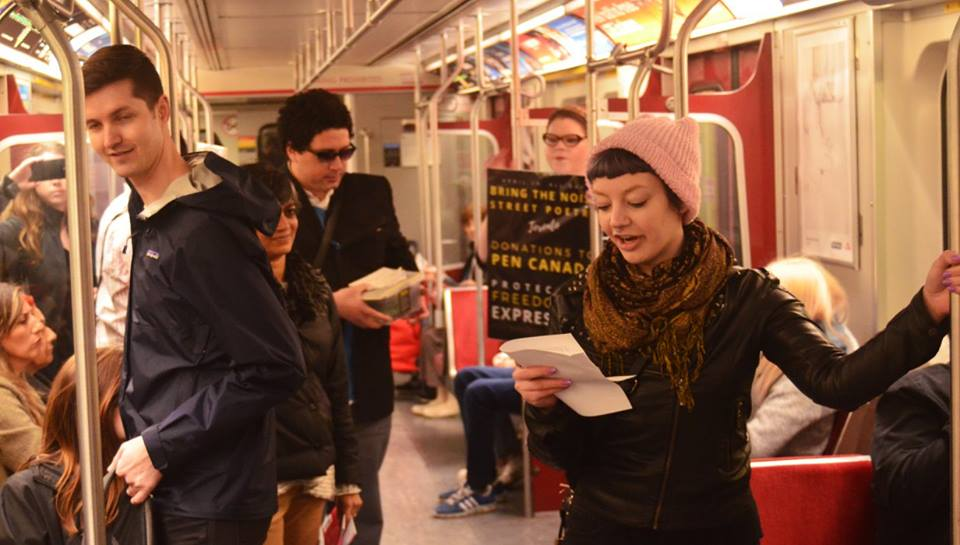 Reading poetry on the subway for the Bring the Noise Street Poetry Tour