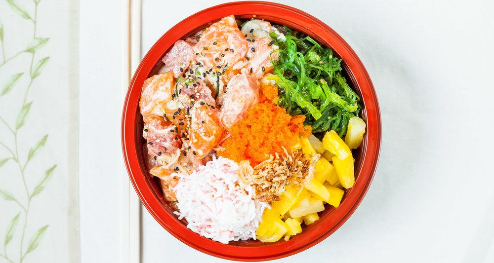 Spoonfish Signature Bowl -  California Coast : Ahi Tuna, Salmon, Albacore, Togarashi Cream, Spoonfish Signature Sauce, Crab Salad, Masago, Seaweed Salad, Pineapple, Green & White Onion, Cucumber, Furikake, Crispy Onion.