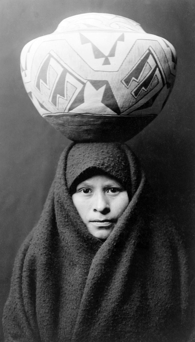 Zuni-girl-with-jar.png