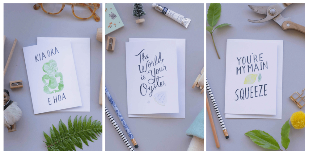 """Photo: Examples of Emma's prints sold in Iko Iko, Wellington NZ (Left to right: """"Kia Ora E Hoa"""" Card, """"The world is your oyster"""" card, """"You're my main squeeze"""" card)."""