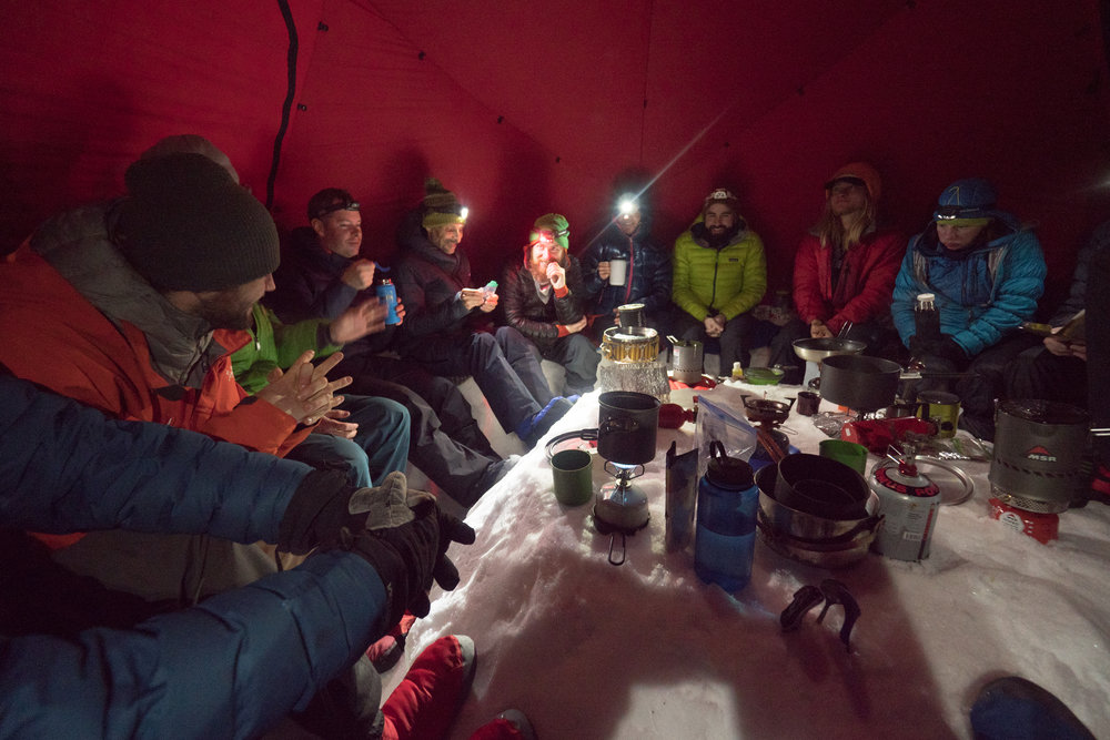 For our Duffey Fest, all gear is hiked in. Short days meant enjoying the comfort of cooking in one of our tents as a group. Photo Peter Wojnar.