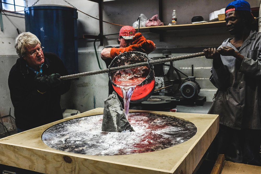 Red-hot molten Aluminium being poured into the pre-built mould cavity for the  Lunar Table.   (Photo by Devin Paisley)