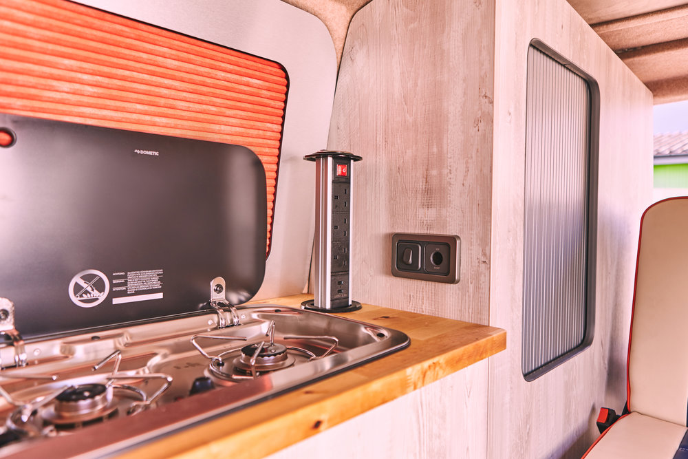 Home comforts. - Our full width kitchen benefits from a double hob, sink, fold tap, power tower with three sockets and two USB's. The satin silver tambour doors conceal your storage area and match the Waeco CRX50 fridge.At North West Dubs we love designing camper van conversions, what inspires you?