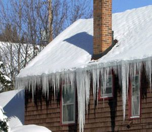 Merrimac, ma storm damage / ice dam / roof leak insurance claim.