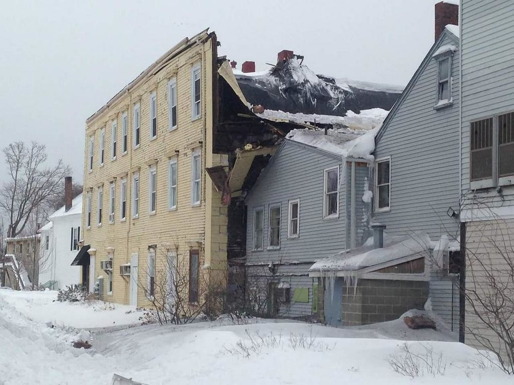 Wenham, ma insurance claim for ice dam / roof collapse from winter storm.